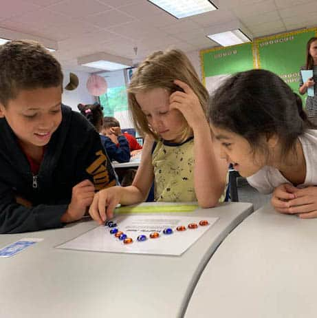 Three Jackson-Via students enjoy a whole-class gifted activity.
