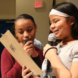 Two students perform their original lyrics in the hip hop workshop.