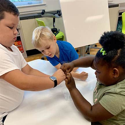 Clark students collaborate in a STEM activity.
