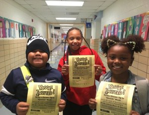 "Students holding ""Bring Your Parents to Special"" flyers."