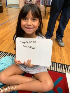 "Student showing sign that says ""I am thankful for my brother."""