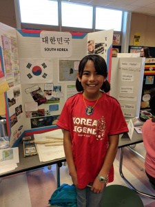 Student displays project at Multicultural Day.