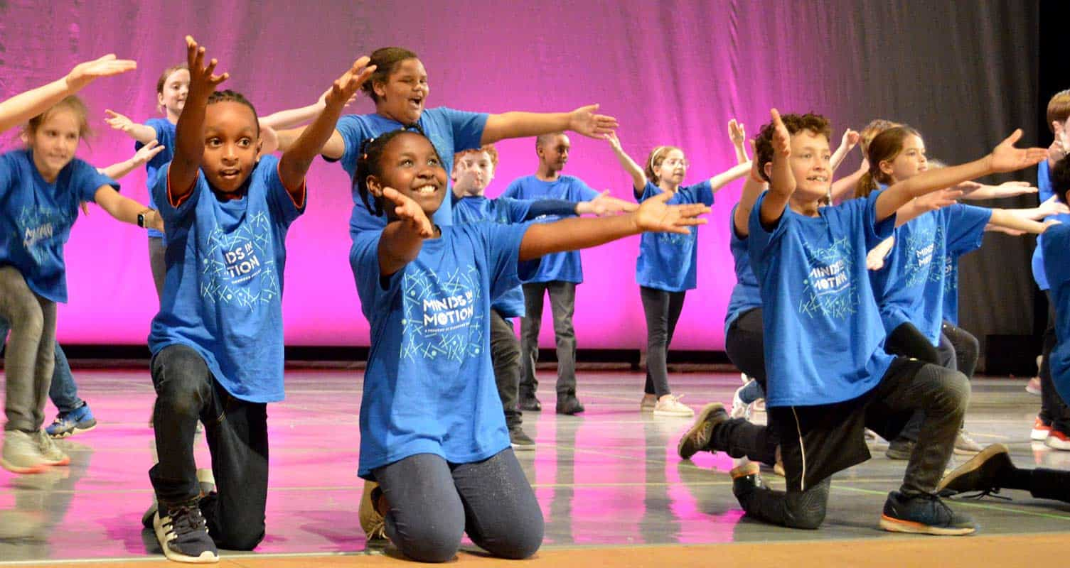 Fourth-graders dance during Minds in Motion