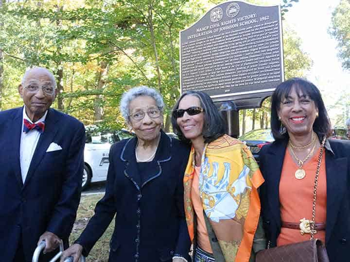 Williams family in front of Johnson historic marker.