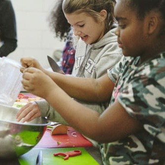 Walker students participate in cooking club.