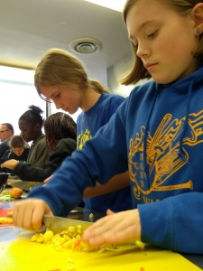 Walker cooking club-girl chopping vegetables
