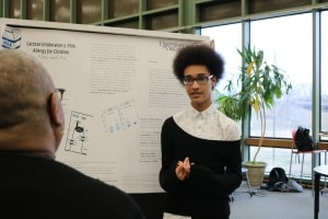 Student explaining research project to judge.