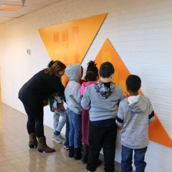 Teacher and students in renovated Jackson-Via hallway