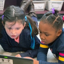 Two girls participate in Hour of Code activity at Venable.
