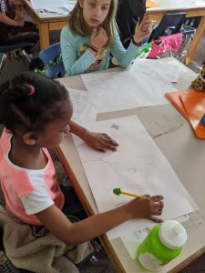 Students draw their reflections after attending field trip to Monacan Nation.
