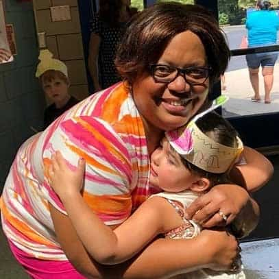 Staff and K student hug at Greenbrier's kindergarten camp 2019