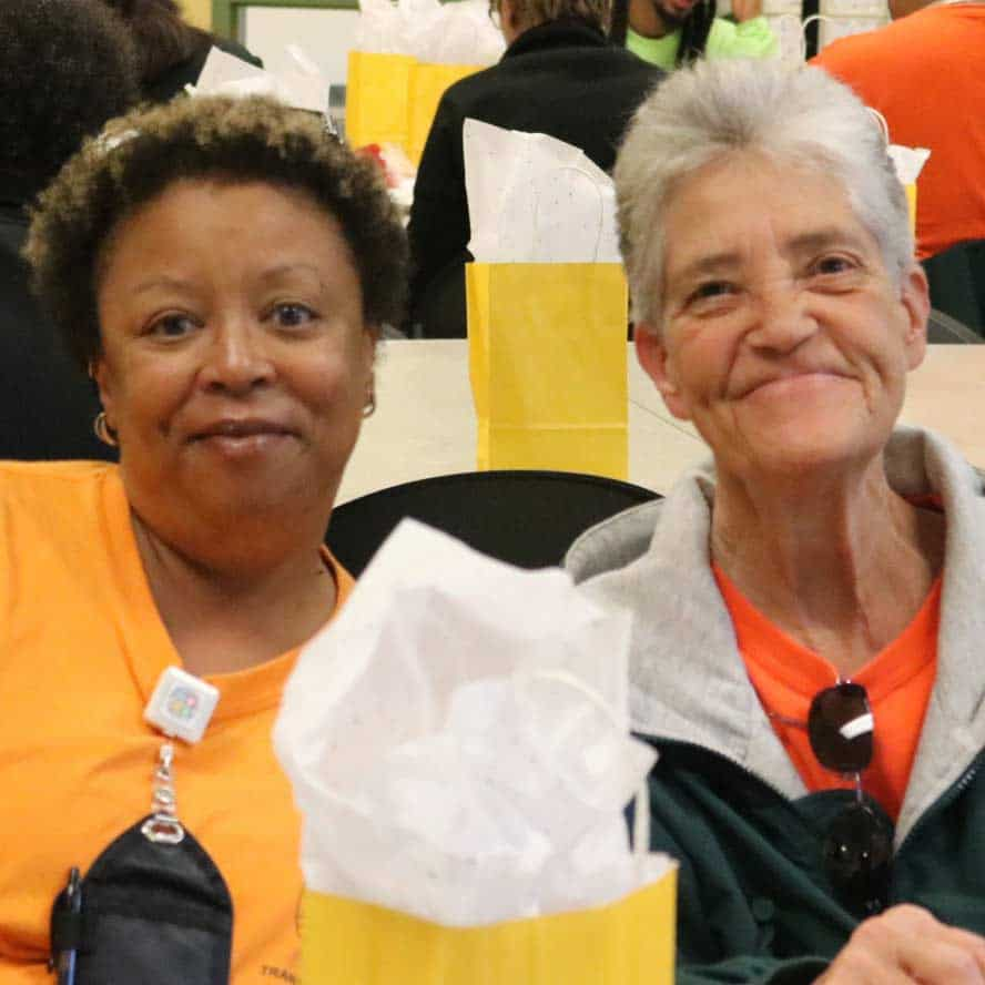 Two bus drivers at a Cville Schools appreciation event